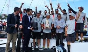 Line-honours-winning-crew-Miss-Scarlet-with-the-trophy_credit-Eye-Sky